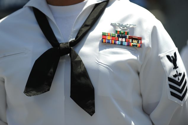 A US Navy sailor awaits the start of his re-enlistment ceremony on July 28, 2011 outside the Staples Center in downtown Los Angeles in conjunction with the Summer X-Games. Earlier this year US President Barack Obama asked the Pentagon to find $400 billion in cuts to national security but as the August 2 debt ceiling deadline approaches some members of Congress have suggested doubling that number to cut $800 billion from defense spending as part of efforts to reduce the nation's $14.3 trillion debt. AFP PHOTO / Robyn Beck (Photo credit should read ROBYN BECK/AFP/Getty Images)