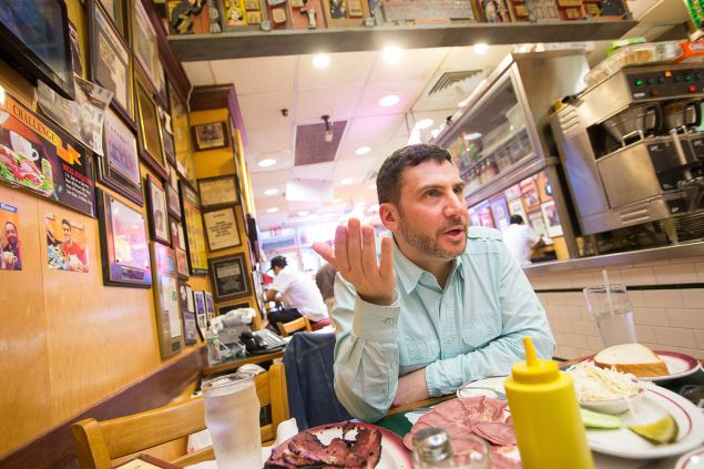 Author Ted Merwin kibitzes over platters of pastrami and beef tongue at Ben's Best in Queens. (Photo: Michael Nagle for Observer)