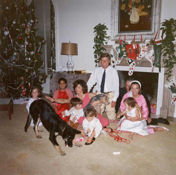 U.S. President John F. Kennedy (1917 - 1963) (C) and First Lady Jacqueline Kennedy (1929 - 1994) pose with their family on Christmas Day at the White House, Washington, D.C., December 25, 1962. (L-R): Caroline Kennedy, unidentified, John F. Kennedy Jr. (1960 - 1999), Anthony Radziwill (1959 - 1999), Prince Stanislaus Radziwill, Lee Radziwill, and their daughter, Ann Christine Radziwill. (Photo by John F. Kennedy Library/Courtesy of Getty Images)