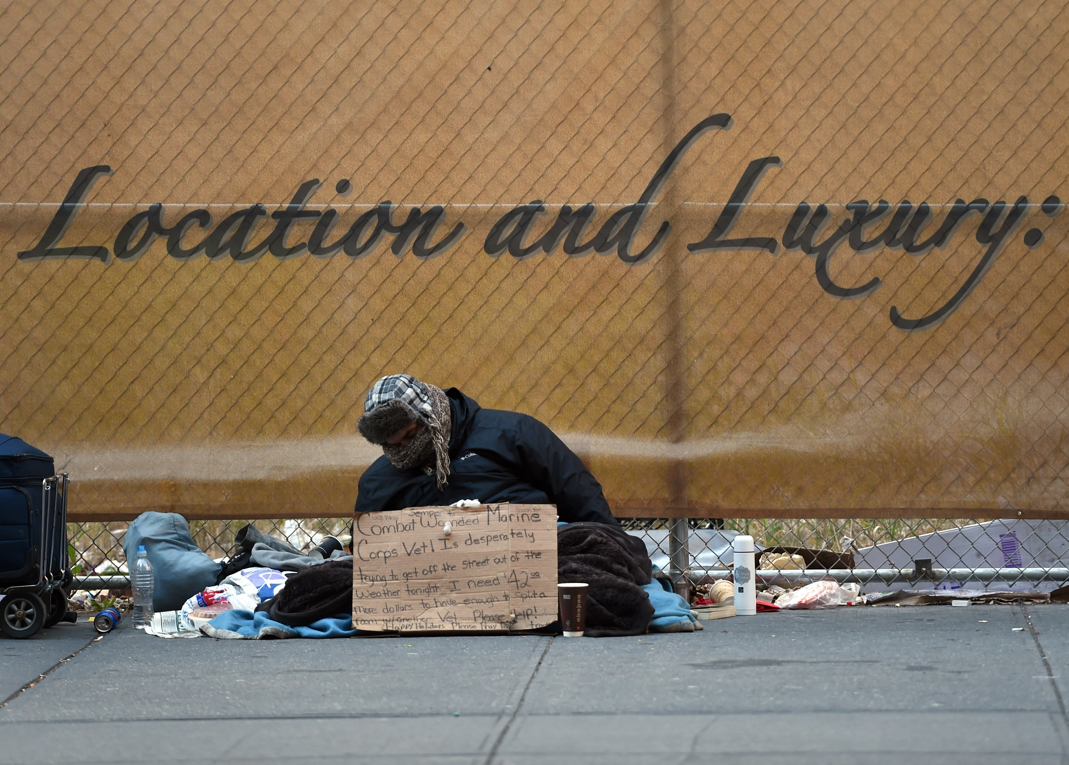 A homeless man looking for money for a room sits on 5th Avenue near 42nd Street in New York January 4, 2016. (Photo: TIMOTHY A. CLARY/AFP/Getty Images)