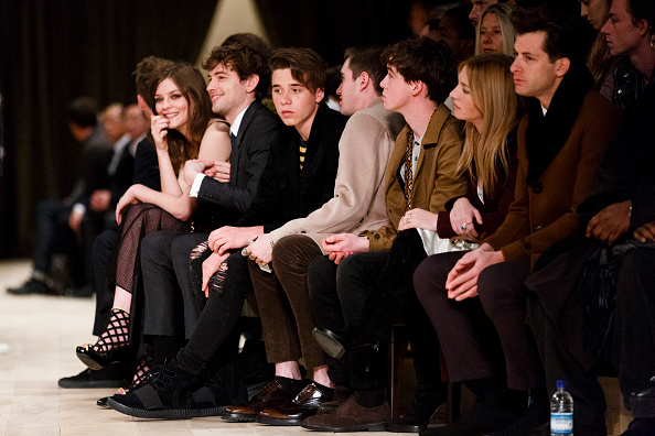 LONDON, ENGLAND - JANUARY 11: Amber Atherton, Josh Whitehouse' Brooklyn Beckham and Gabriel Day-Lewis attend the Burberry show during The London Collections Men AW16 at Kensington Gardens on January 11, 2016 in London, England. (Photo by Tristan Fewings/Getty Images)