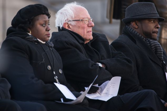 COLUMBIA, SC - JANUARY 18: Democratic presidential candidate Sen. Bernie Sanders (I-VT) (C) listens to a speaker during the King Day at the Dome rally at the S.C. State House January 18, 2016 in Columbia, South Carolina. The event drew appearances from Democratic presidential candidates Sen. Bernie Sanders, I-Vt, former Maryland Gov. Martin O'Malley and Hillary Clinton. (Photo by Sean Rayford/Getty Images)