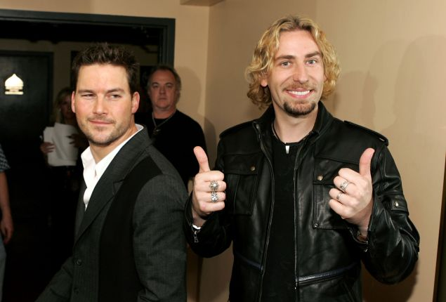 Chad Kroeger (Right) poses backstage at the 2006 American Music Awards with musician Ryan Peake. (Photo by Frazer Harrison/AMA/Getty Images for AMA)