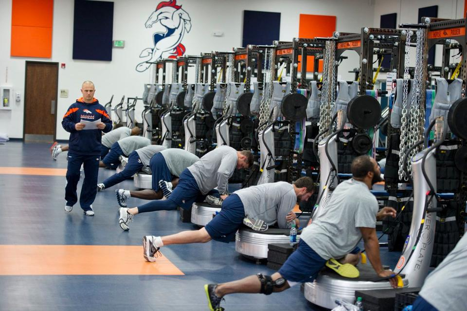 Many football teams, including the Broncos, use Power Plates during their team workouts (Photo: Power Plate).