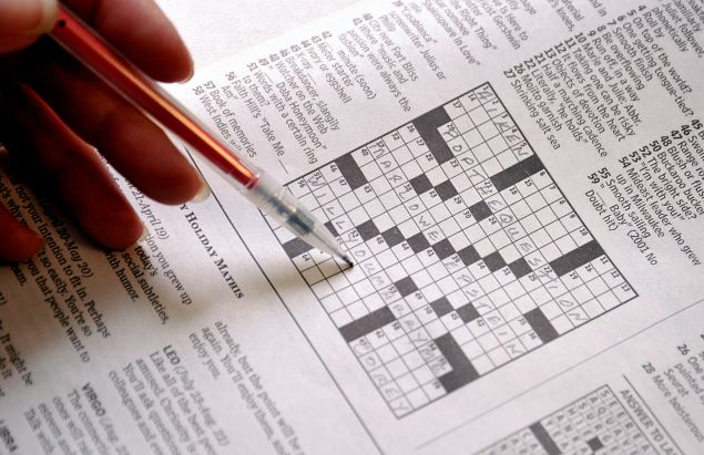 """This April 18, 2011 photo shows the April 17 Sunday Washington Post crossword puzzle. The Washington Post crossword puzzle had special meaning this weekend for one local couple. With the complicity of the newspaper, Corey Newman, 28, of Alexandria, Virginia, proposed to his live-in girlfriend, Marlowe Epstein, 31, through clues buried in a specially-crafted puzzle.The clue for 37 Across, for example, asked for the name of a role in the movie """"Shakespeare in Love."""" The answer -- Marlowe. 39 Across asked for the name of a """"Casablanca"""" screenwriter. The answer -- Epstein. The clincher was 51 Across: """"Words with a certain ring to them."""" As soon as Epstein came up with the answer -- """"Will you marry me"""" -- Newman got down on one knee, whipped out a diamond ring and repeated the question, the Post reported. """"Yes, of course!"""" Epstein said. AFP PHOTO/Karen BLEIER (Photo credit should read KAREN BLEIER/AFP/Getty Images)"""