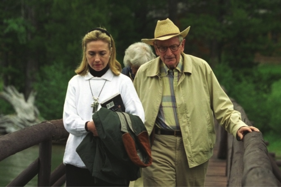 Hillary Clinton with Laurance Rockefeller at the JY Ranch, Jackson Hole, WY, August 21, 1995. Clinton is carrying the book Are We Alone: Philosophical Implications of the Discovery of Extraterrestrial Life by Paul Davies. (Photo: National Archives)