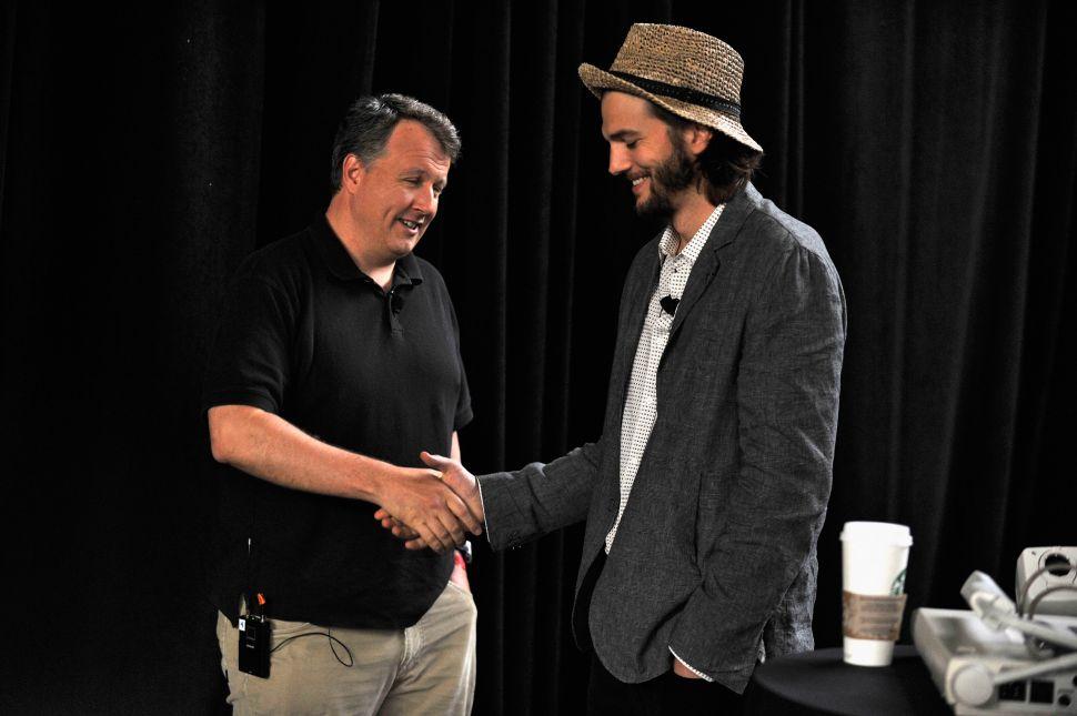 Paul Graham (left) with Ashton Kutcher, at TechCrunch Disrupt. (Photo: Joe Corrigan/Getty)