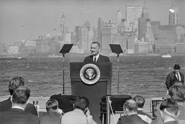 12th October 1965:  American President Lyndon Baines Johnson (1908 - 1973) speaking after he had signed the new Immigration Bill at the foot of the Statue of Liberty. In the background is the New York skyline.  (Photo by Harry Benson/Express/Getty Images)