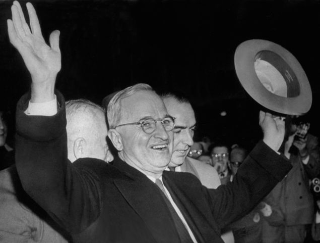 1948: American President, Harry S Truman smiles and waves to the excited Kansas City crowd after hearing the news that he had won the United States elections and retained the Presidency. (Photo by Keystone/Getty Images)