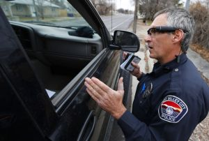 WEST VALLEY CITY, UT - MARCH 2: West Valley City patrol officer Gatrell performs a traffic stop on the first day of use of his newly-issued body camera attached to the side of a pair of glasses on March 2, 2015 in West Valley City, Utah. West Valley City Police Department has issued 190 Taser Axon Flex body cameras for all it's sworn officers to wear starting today.