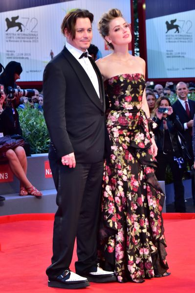 "US actress Amber Heard arrives with her husband US actor Johnny Depp for the screening of the movie ""The Danish Girl"" presented in competition at the 72nd Venice International Film Festival on September 5, 2015 at Venice Lido. AFP PHOTO / GIUSEPPE CACACE (Photo credit should read GIUSEPPE CACACE/AFP/Getty Images)"