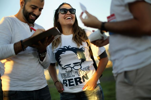 MANASSAS, VA - SEPTEMBER 14: Supporters sign a petition to get Democratic presidential candidate Sen. Bernie Sanders (I-VT) on the ballot in Virginia during a campaign rally at the Prince William County Fairground September 14, 2015 in Manassas, Virginia. Sanders addressed 12,000 students at Christian Liberty University earlier in the day. (Photo by Chip Somodevilla/Getty Images)
