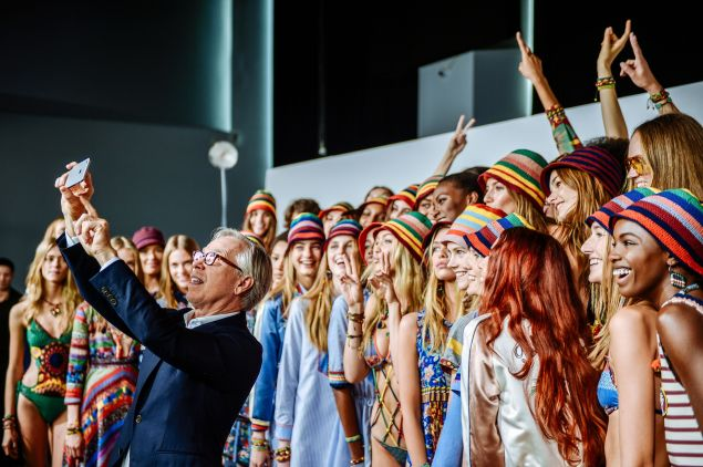 Tommy Hilfiger snaps a selfie with the models at his Spring 2016 show (Photo: Grant Lamos IV/Getty Images for Tommy Hilfiger).