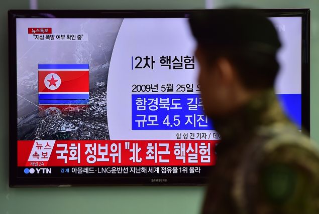 CORRECTION - YEAR A South Korean soldier walks past a television display showing a news report at a railroad station in Seoul on January 6, 2016, after seismologists detected a 5.1 magnitude tremor next to North Korea's main atomic test site in the northeast of the country. North Korea said on January 6 it had successfully carried out its first hydrogen bomb test, marking a major step forward in its nuclear development if confirmed. AFP PHOTO / JUNG YEON-JE / AFP / JUNG YEON-JE (Photo credit should read JUNG YEON-JE/AFP/Getty Images)