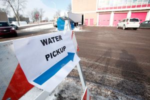 Sign pointing to clean water pick up in Flint, Michigan