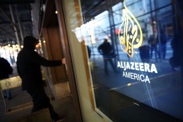 NEW YORK, NY - JANUARY 13: The logo for Al Jazeera America is displayed outside of the cable news channel's offices on January 13, 2016 in New York City. Al Jazeera America, which debuted in August 2013, announced today that they are shutting down. Employees of the struggling news network known as AJAM were informed of the decision during an all-hands staff meeting on Wednesday afternoon. (Photo by Spencer Platt/Getty Images)