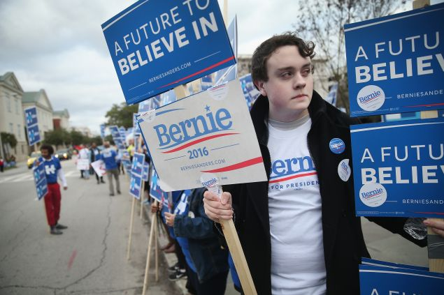 CHARLESTON, SC - JANUARY 17: Supporters of Democratic presidential candidates Senator Bernie Sanders (I-VT) and Hillary Clinton rally outside the Gaillard Center before the start of the NBC News Democratic Candidates Debate on January 17, 2016 in Charleston, South Carolina. This is the final debate for the Democratic candidates before the Iowa caucuses. (Photo by Scott Olson/Getty Images)