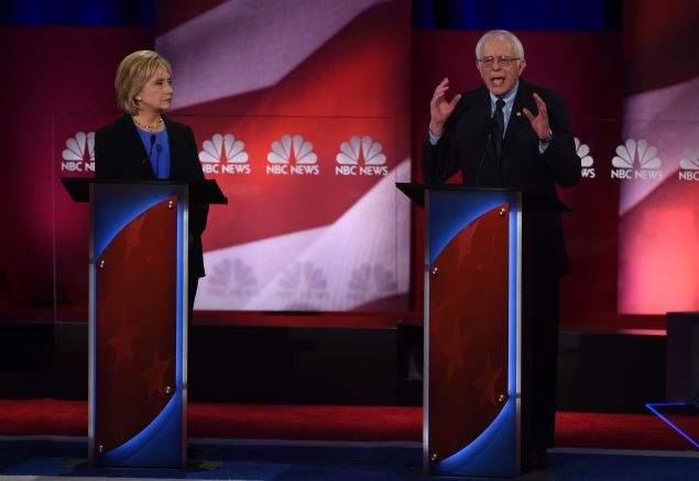 Former Secretary of State Hillary Clinton and Vermont Sen. Bernie Sanders. Not pictured: ex-Maryland Gov. Martin O'Malley (TIMOTHY A. CLARY/AFP/Getty Images)