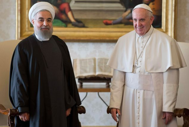 Pope Francis (R) and Iranian President Hassan Rouhani poses after their private audience on January 26, 2016, at the Vatican. Rouhani on January 26 described Iran as the safest and most stable country in the Middle East as he urged international investors to help modernise the country's sanctions-hit economy. On the second day of a landmark visit to Europe, the Iranian leader also pitched the Islamic Republic's potential for companies seeking a base in a region of 300 million people and vowed the government would never interfere in private business deals. / AFP / POOL / ANDREW MEDICHINI (Photo credit should read ANDREW MEDICHINI/AFP/Getty Images)