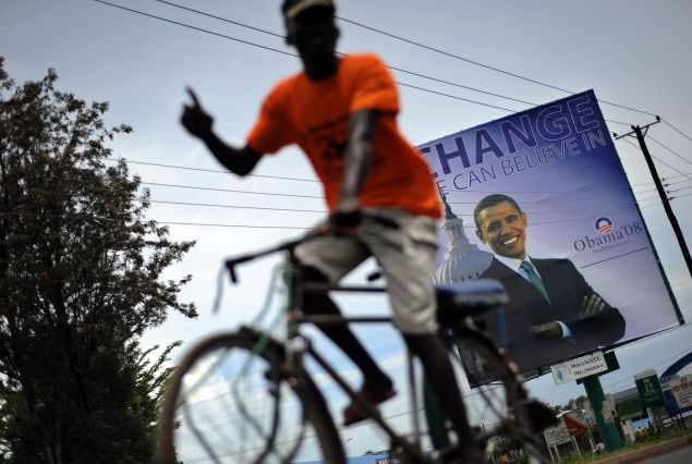 A Kisumu resident raises his index finger to signify 'winner' as he cycles November 02, 2008 past a billboard of US Democratic presidential hopeful Barak Obama now commonly refered to as 'son of Kenya' at the Obama's rural home in Siaya district. Excitement continues to mount in Kisumu, the headquarter of Kenya's Western province as the 'Son of Kenya', a term increasingly used to refer to Barak given his fathers Kenyan origins, as Obama continues to lead his main rival, Republican John McCain in preliminary polls two days to the historic vote.                     AFP PHOTO/Tony KARUMBA (Photo credit should read TONY KARUMBA/AFP/Getty Images)