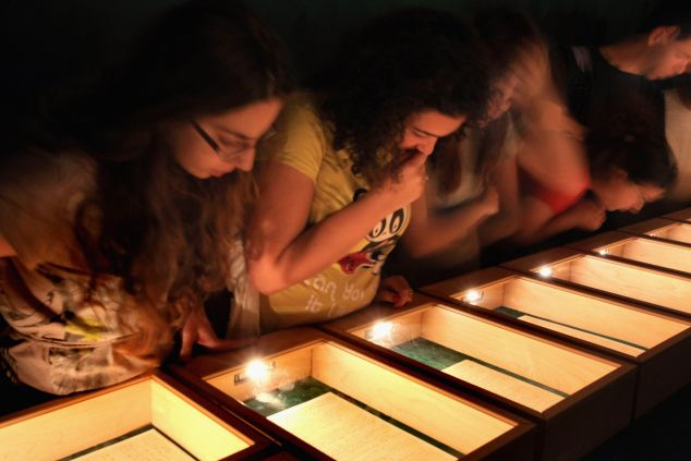 Israeli students inspect Albert Einstein's General Theory of Relativity at the Hebrew University of Jerusalem. (Photo by David Silverman/Getty Images)
