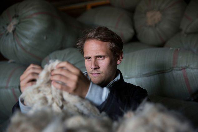 Matt Scanlon inspects cashmere threads (Photo: Courtesy Naadam).