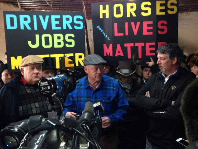 Stable owners Patrick and Cornelius Byrne and driver Ian McKeever protest with workers against the plan to curtail horse carriages (Photo: Will Bredderman for Observer).