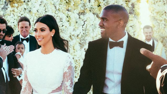 Kim Kardashian and Kanye West (foreground) with Rich Wilkerson Jr. (back right).
