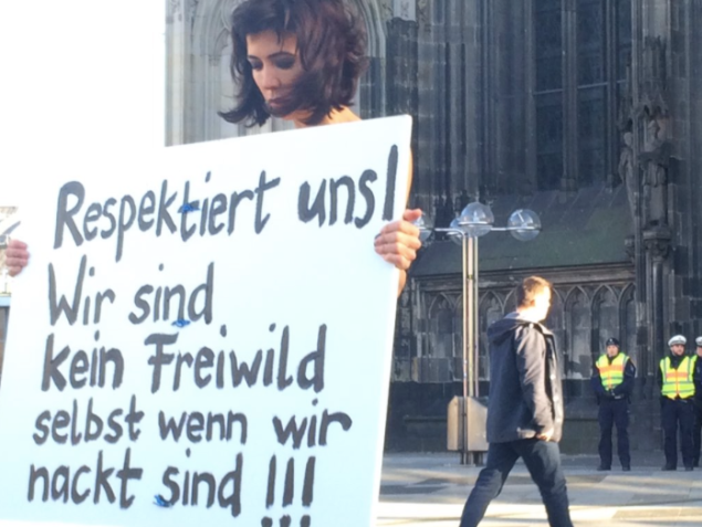 Swiss performance artist Milo Moiré protests violence against women in Cologne. (Photo: Courtesy of Twitter and Bart Biesemans @bart_bies)