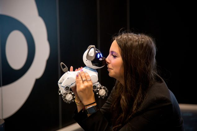 Sydney Wiseman of WowWee USA, holds CHiP's robotic dog.
