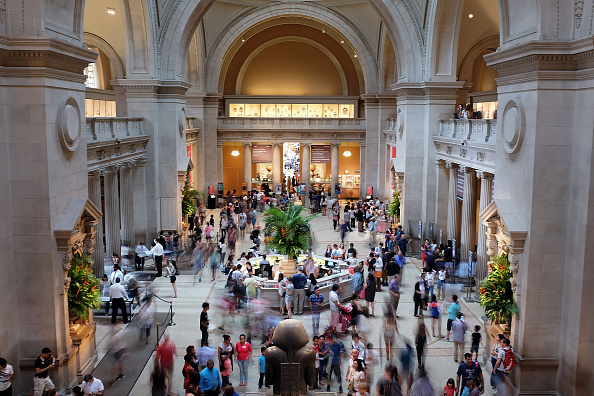 Hundreds of people walk through the Great Hall at the Metropolitan Museum of Art on July 30, 2015.