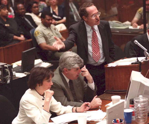 O.J. Simpson defense attorney Alan Dershowitz (standing) pictured during the famous murder trial.