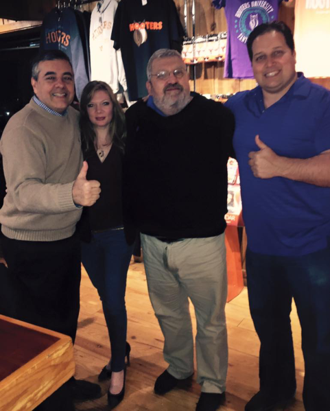 "Lobbyist Dana Hudson posted a photo with David Rivera (far left), pollster Dario Moreno and Rafael ""Ralph"" Perez at an Iowa Hooters while the group campaigned for Mr. Rivera's friend, presidential candidate Marco Rubio. Ms. Hudson is at center-left."