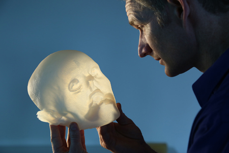 "Artist Gary Staab with a 3-D print of the ""Iceman""'s face."