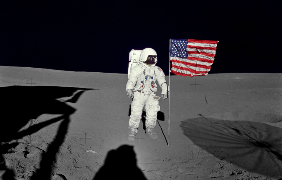 Astronaut Edgar Mitchell, Apollo 14 lunar module pilot stands by the U.S. flag on the lunar surface during the early moments of the mission's first spacewalk. (Credit: NASA)