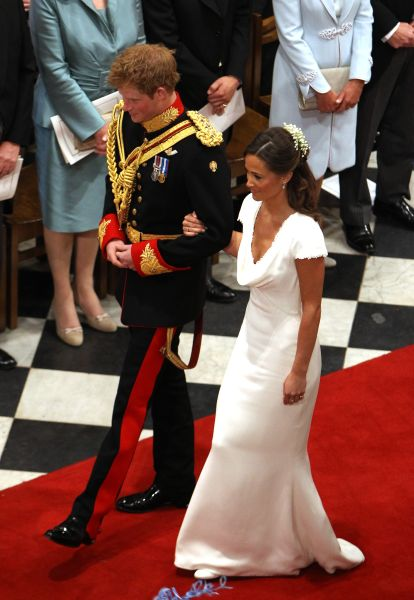 LONDON, UNITED KINGDOM - APRIL 29: Prince Harry and Maid of Honour Pippa Middleton walk down the aisle at Westminster Abbey following the wedding ceremony of Prince William, Duke of Cambridge and Catherine, Duchess of Cambridge on April 29, 2011 in London England. The marriage of the second in line to the British throne was led by the Archbishop of Canterbury and was attended by 1900 guests, including foreign Royal family members and heads of state. Thousands of well-wishers from around the world have also flocked to London to witness the spectacle and pageantry of the Royal Wedding.
