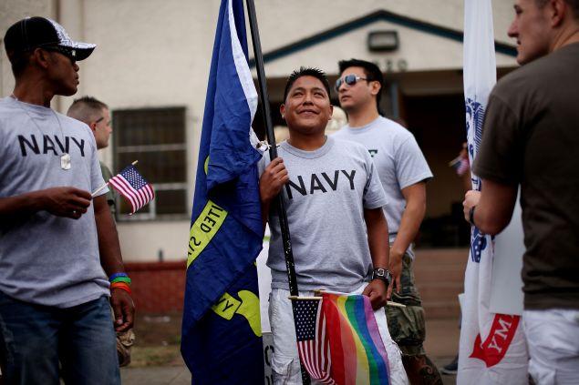 A Navy sailor prepares to march in the July, 2011 San Diego gay pride parade.