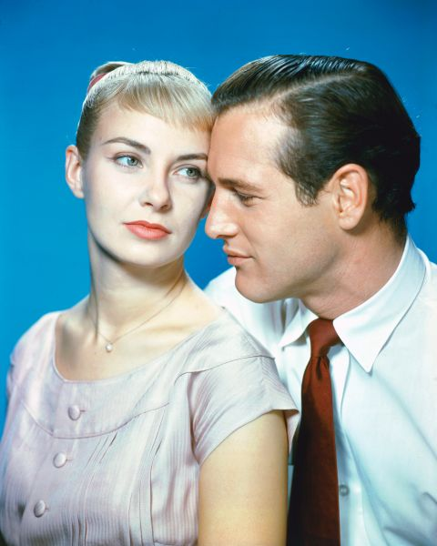 Joanne Woodward, US actress, and Paul Newman (1925-2008), US actor, in a studio portrait, against a blue background, issued as publcity for the film, 'The Long Hot Summer', 1958. The drama, directed by Martin Ritt (1914-1990), starred Woodward as 'Clara Varner', and Newman as 'Ben Quick'.