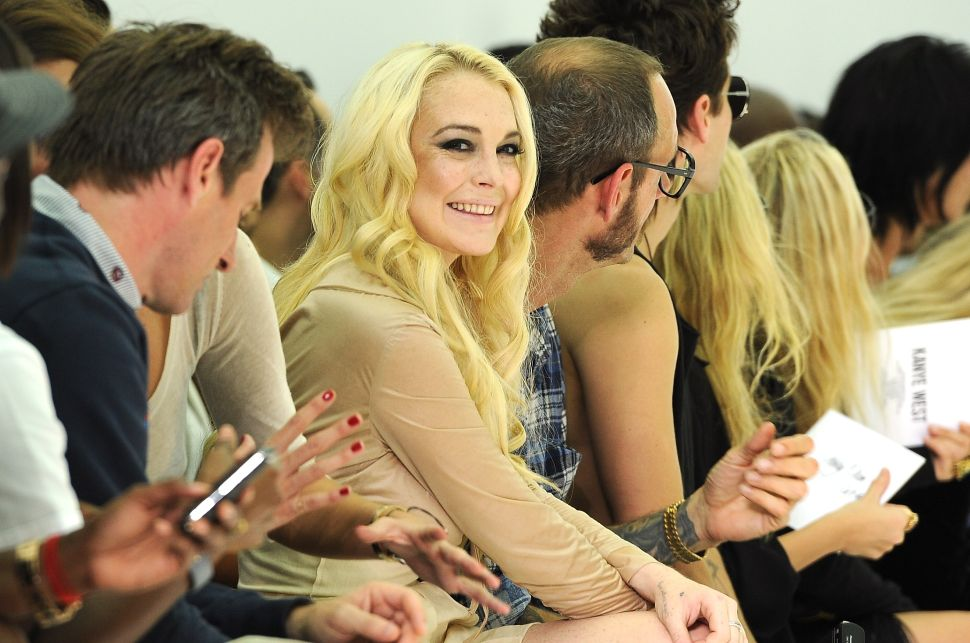Lindsay Lohan attends Dw by Kanye West (Photo by Pascal Le Segretain/Getty Images)