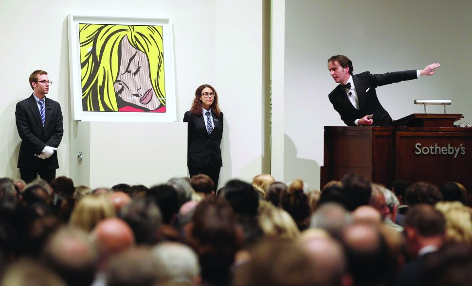 "NEW YORK, NY - MAY 09: Roy Lichtenstein's 'Sleeping Girl' is auctioned at Sotheby's on May 9, 2012 in New York City. The market for contemporary art has been on fire in recent months with Edvard Munch's ""The Scream"" posting an auction record of $119 million at Sotheby's on May 2. (Photo by Mario Tama/Getty Images)"