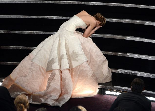 "HOLLYWOOD, CA - FEBRUARY 24: Actress Jennifer Lawrence reacts after winning the Best Actress award for ""Silver Linings Playbook"" during the Oscars held at the Dolby Theatre on February 24, 2013 in Hollywood, California."