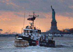 NEW YORK - JANUARY 28: In this handout image provided by the U.S. Coast Guard, the Coast Guard Cutter Wire, a 65-foot icebreaking tug homeported in Saugerties, New York makes its way through an ice flow January 28, 2004 in New York Harbor. As severe ice conditions still exist in the Northeast, U.S. Coast Guard ice breakers have been working continuosly keeping waterways open for maritime traffic. (Photo by Mike Lutz/USGC via Getty Images)