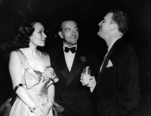 circa 1928: Actress Dolores Del Rio with her art director husband Cedric Gibbons, and Fritz Lang at the Rathbone party. Cedric designed the Oscar statuette for the Academy Awards.