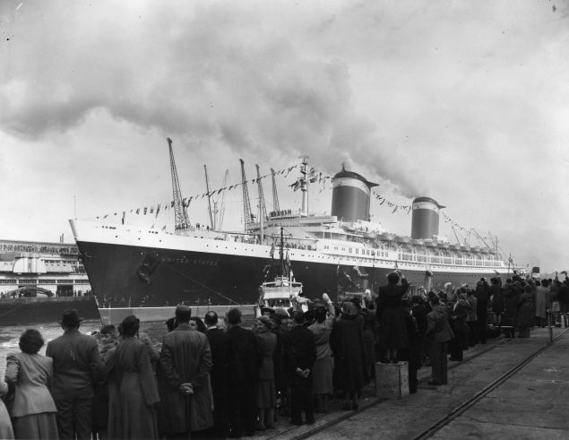 1952: Cheering crowds lining the quayside as the record breaking liner, SS United States arrives in Southampton. She crossed the Atlantic in record time on her maiden voyage. (Photo by M. Fresco/Topical Press Agency/Getty Images)