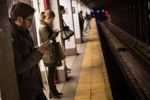 Subway riders wait for the train. (Photo Andrew Burton/Getty Images)