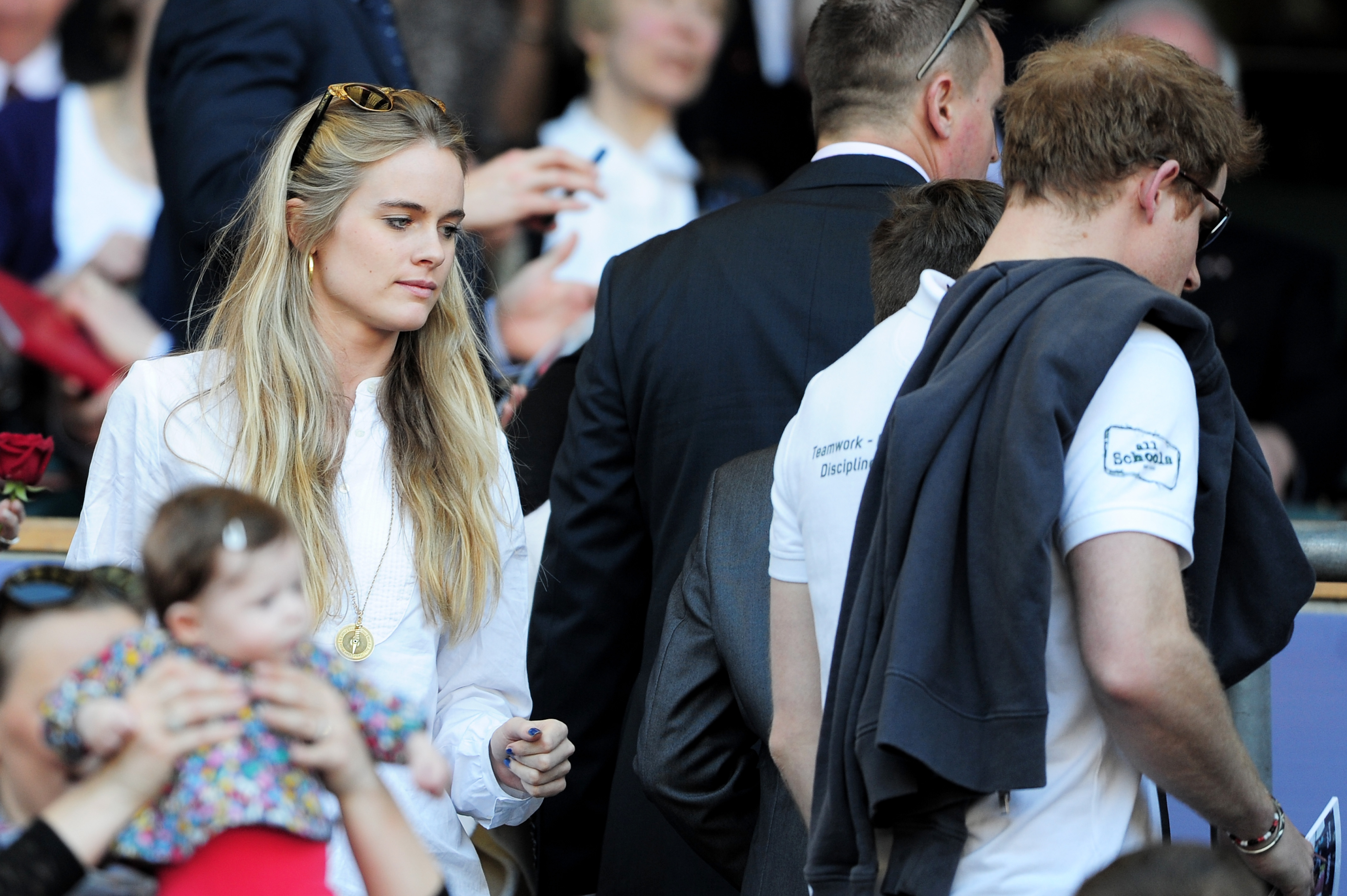 LONDON, ENGLAND - MARCH 09: Prince Harry (R) and Cressida Bonas (L) take their seats during the RBS Six Nations match between England and Wales at Twickenham Stadium on March 9, 2014 in London, England. (Photo by Shaun Botterill/Getty Images)