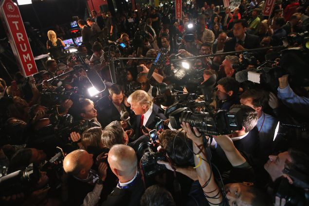 Republican presidential candidate Donald Trump talks to reporters in the 'Spin Alley' after the first prime-time presidential debate hosted by FOX News and Facebook at the Quicken Loans Arena August 6, 2015 in Cleveland, Ohio.