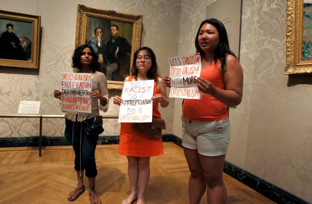 "Protesters objected to the MFA's ""Kimono Wednesday"" event, where the museum invited visitors to try on a replica kimono in front of Claude Monet's ""La Japonaise."" The museum had kimonos for people to try on and pose as Camille Monet did in the painting. (Photo John Blanding/The Boston Globe via Getty Images)"