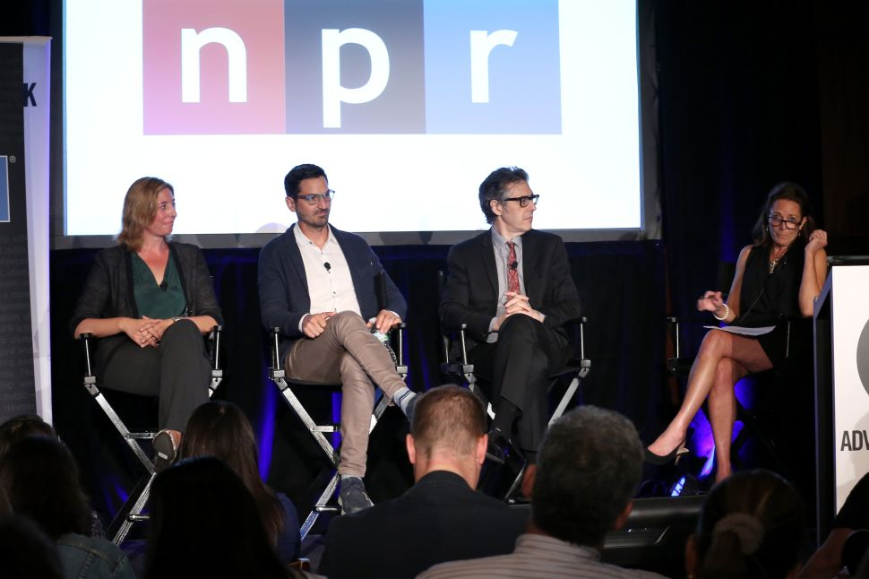 NEW YORK, NY - SEPTEMBER 28: (L-R) Host and Senior Tech Correspondent for Marketplace Molly Wood, Host and Editorial Director TED Radio Hour Guy Raz, Creator and Host This American Life Ira Glass, and President and CEO National Public Media Gina Garrubbo speak onstage at the The On Demand Audio and Podcast Revolution: Building Passionate Audiences And Great Resonance For Brands panel during Advertising Week 2015 AWXII at Lucille's at B.B. King Blues Club and Grill on September 28, 2015 in New York City. (Photo by Paul Zimmerman/Getty Images for AWXII)
