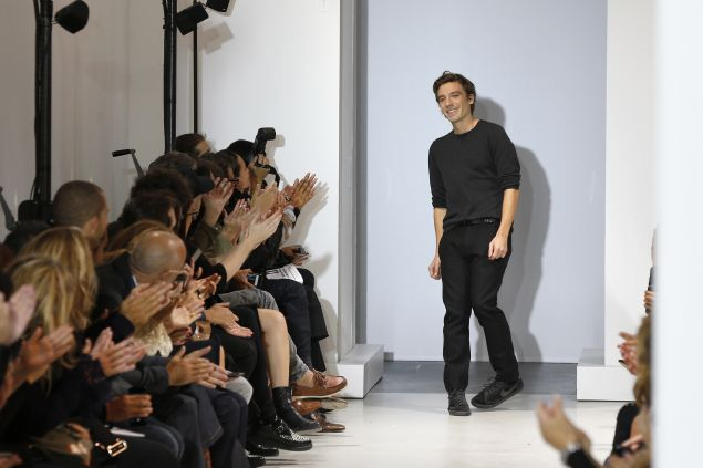 Designer Julien Dossena takes a bow at the Spring/Summer 2016 Paco Rabanne show